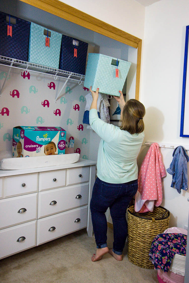 woman-organizing-nursery-closet