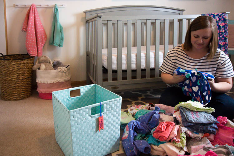 pile-of-outgrown-baby-clothes-on-floor