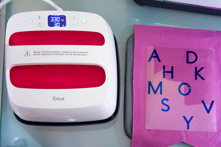cricut-easypress-with-purple-fabric-banner-on-table