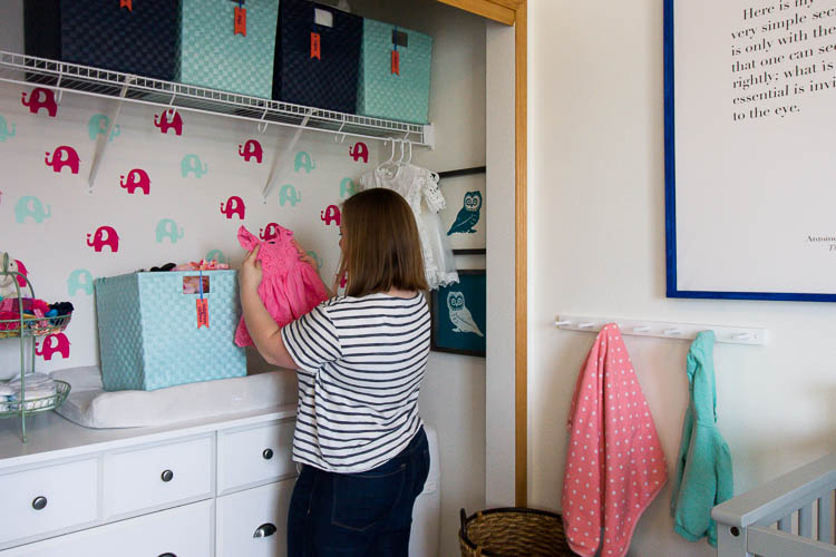 folding-baby-clothes-in-nursery