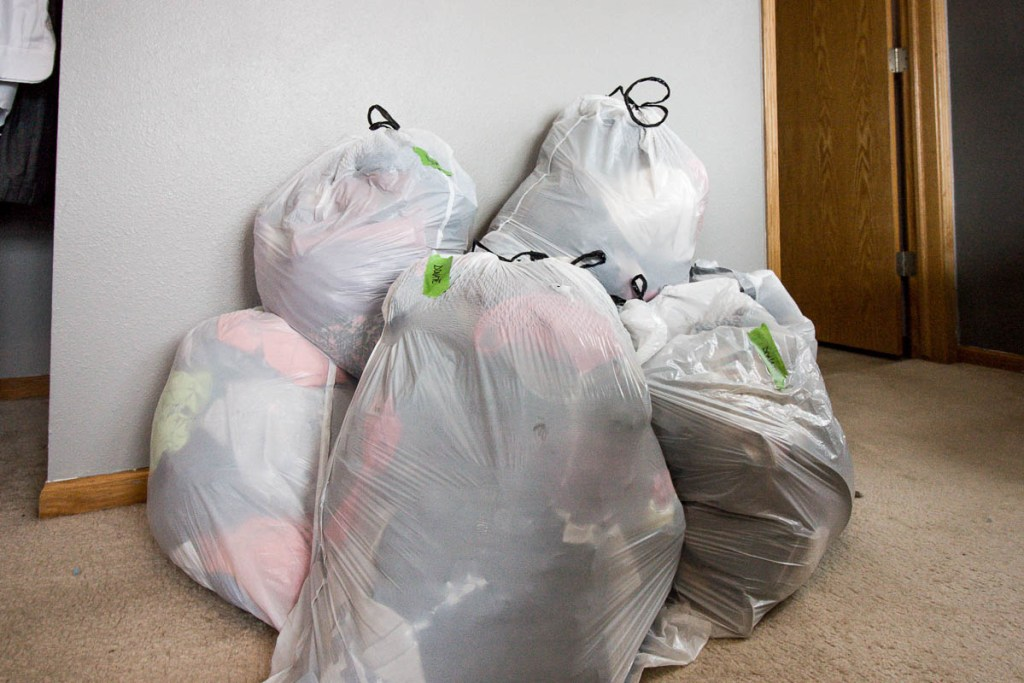 pile-of-garbage-bags-filled-with-clothes