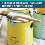 clare-paint-cans-and-painting-supplies-on-floor