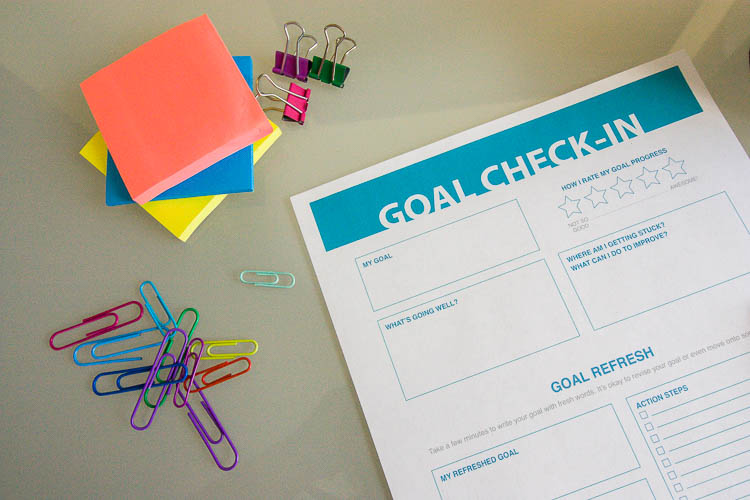 goal-setting-worksheet-and-office-supplies-on-table