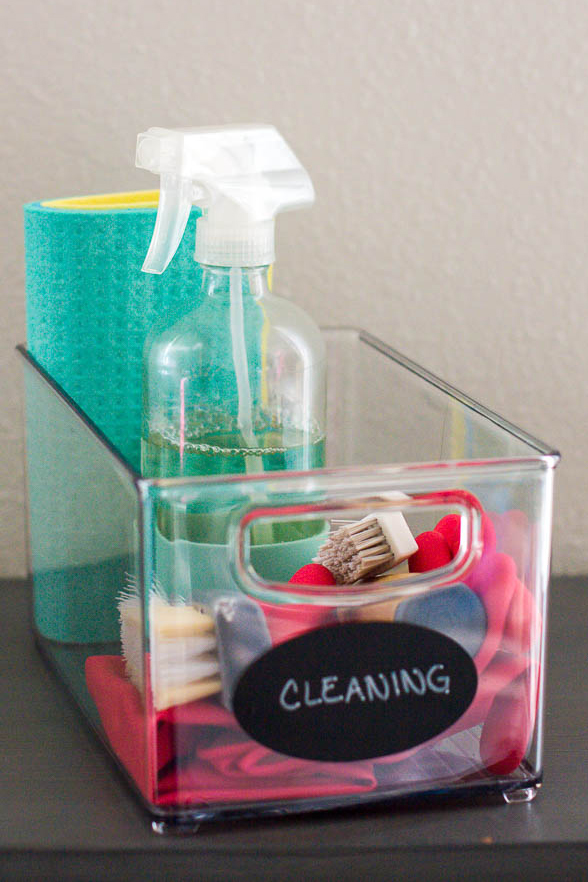 oval-chalkboard-label-on-storage-bin-of-cleaning-supplies