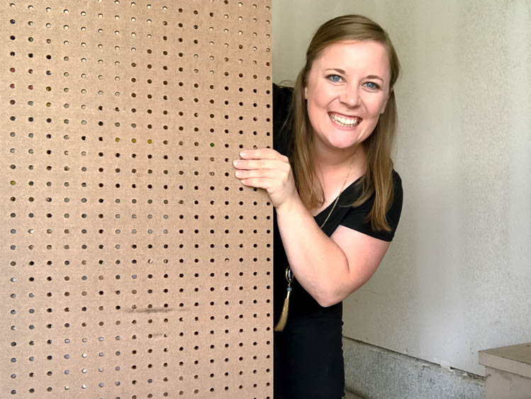 thrift-shop-challenge-emily-counts-holding-pegboard