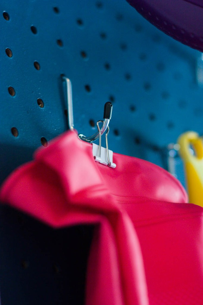 closeup-of-rubber-gloves-hanging-on-pegboard
