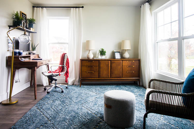 navy-area-rug-in-living-room-with-office-corner