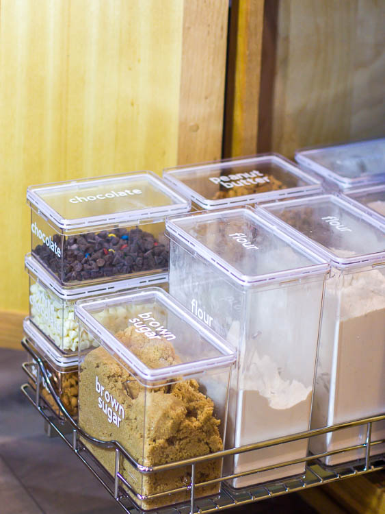 pull-out-drawer-in-kitchen-cabinet-with-organized-baking-supplies