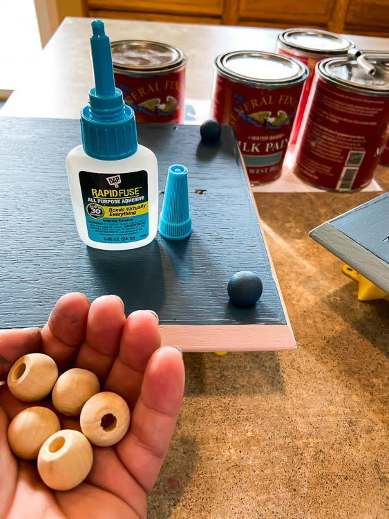 wooden beads glued on diy tray as feet