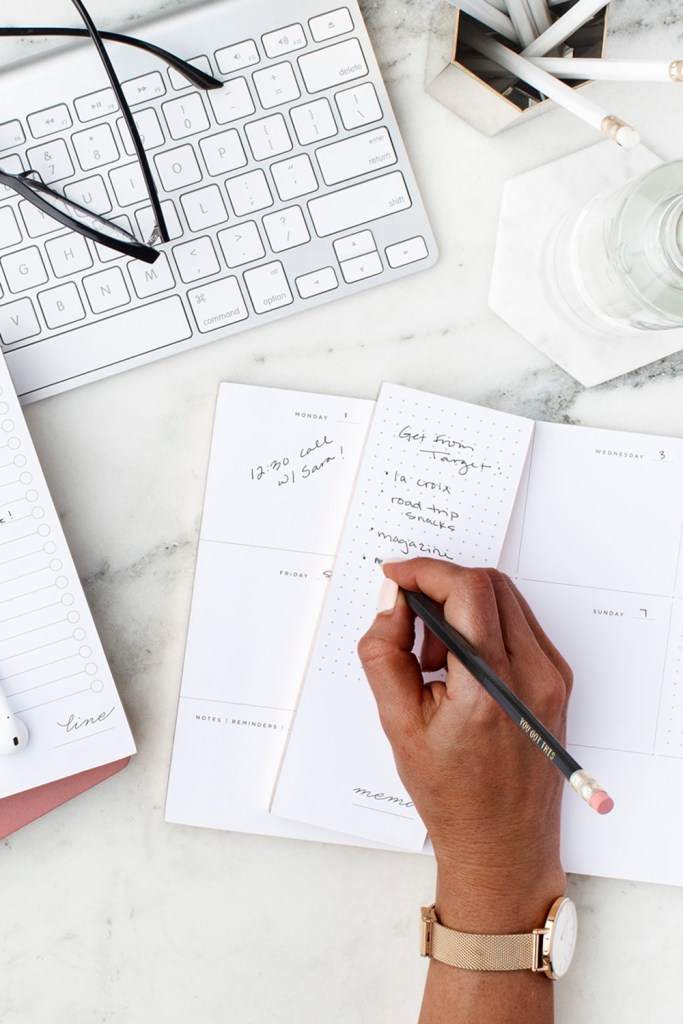 hand-writing-in-planner