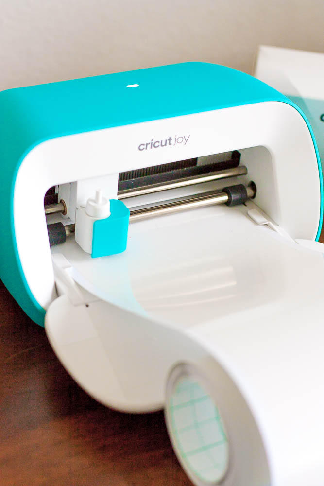 close up of Cricut Joy machine cutting white label vinyl