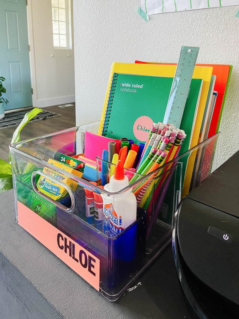 portable homework caddy with small compartments filled with school supplies