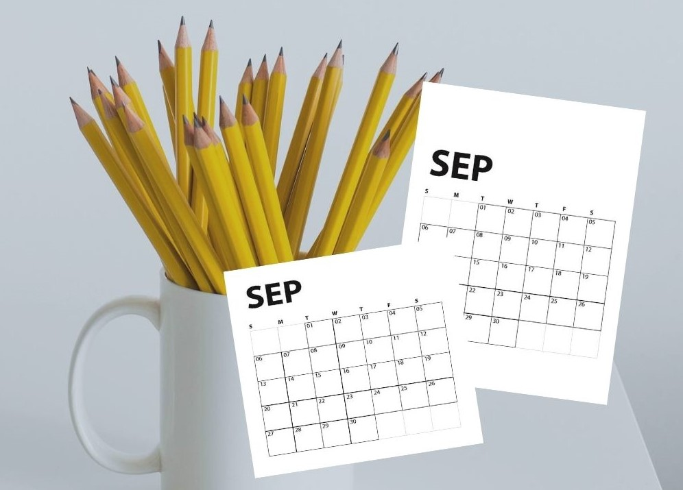 white coffee mug full of yellow pencils and overlay of September calendars