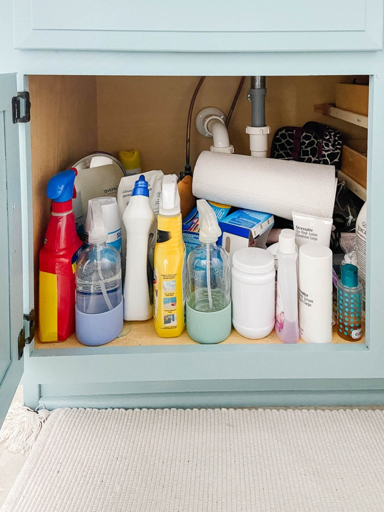 bathroom vanity cabinet with cleaning products
