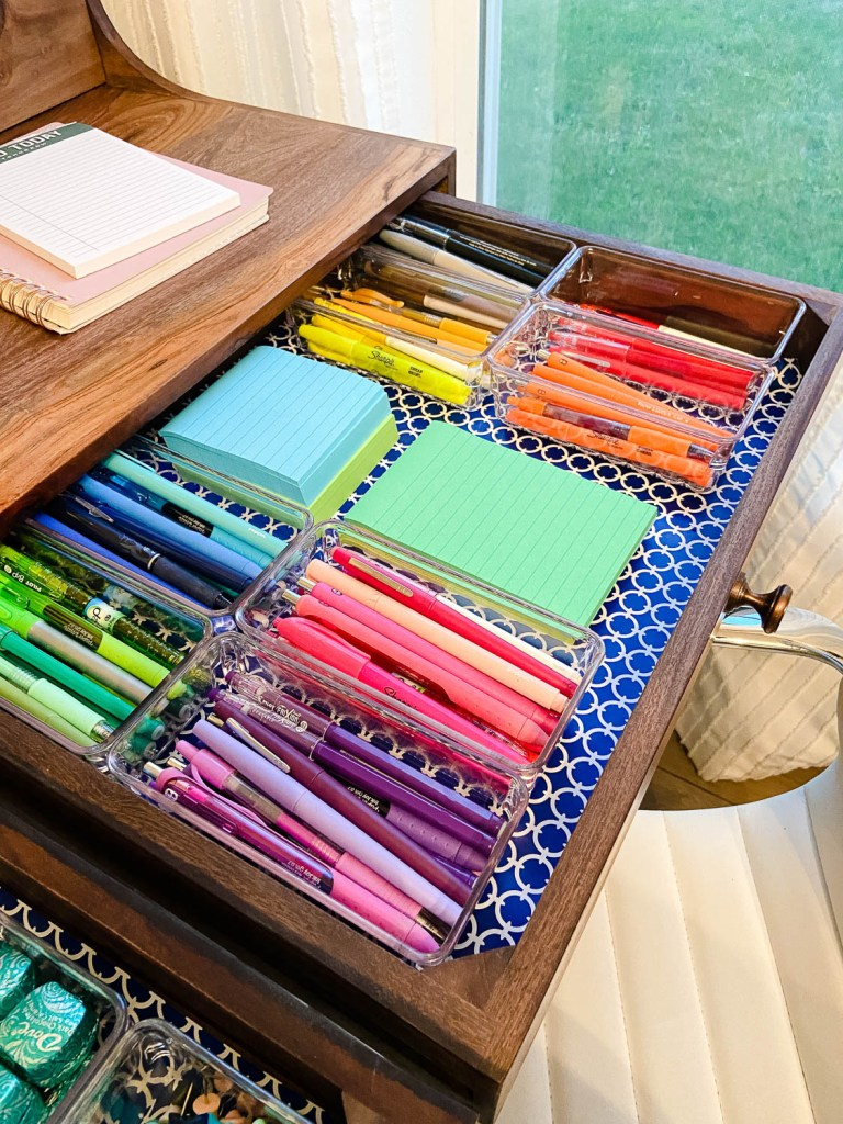 desk drawer with organized office supplies