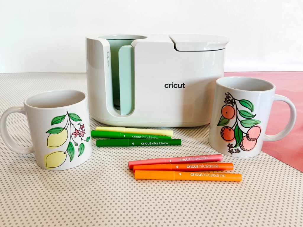 Cricut Mug Press with two mugs on table