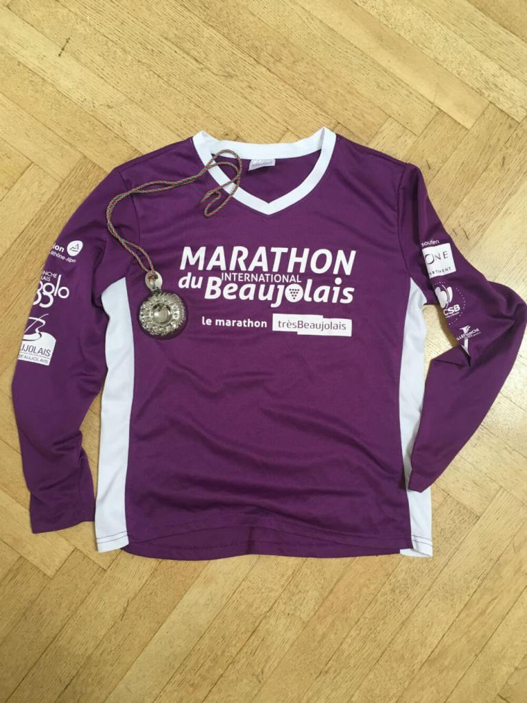 Running helped me transition, French marathon shirt and medal