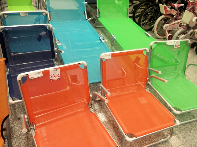 Beach chairs at grocery store in Greece.