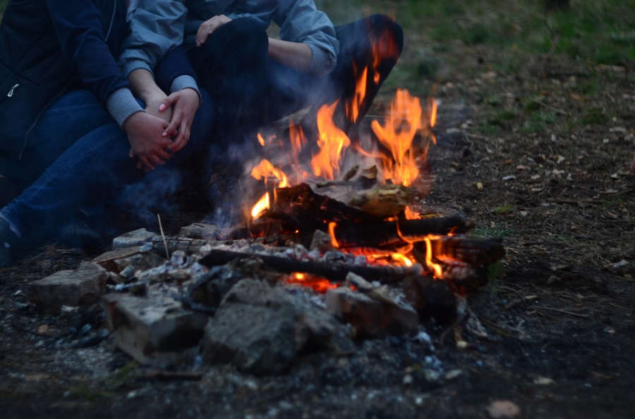 Romantic weekend camping and snuggling by the campfire.
