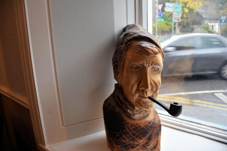 Tom Crean wood sculpture in Kenmare, Ireland.