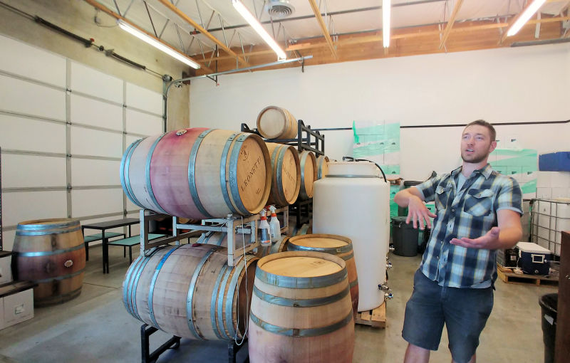 The barrel room and the winemaker at Par Terre Winery in Garden City, Idaho.