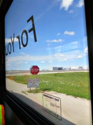 Tour bus window as we drive on the infield terminal.