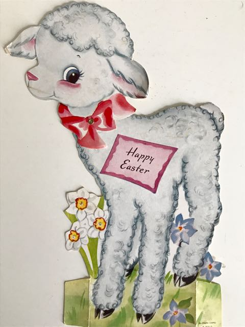 Easter card in form of a lamb with tag reading 'Happy Easter'.