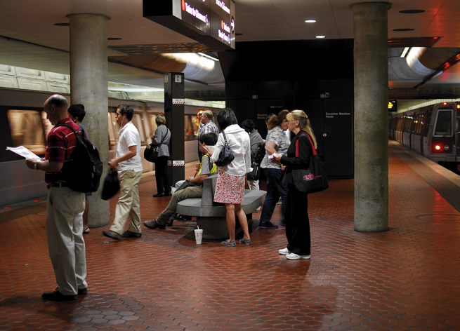 Passengers waiting for the Metro at gallery Place Metro Station in Washington DC