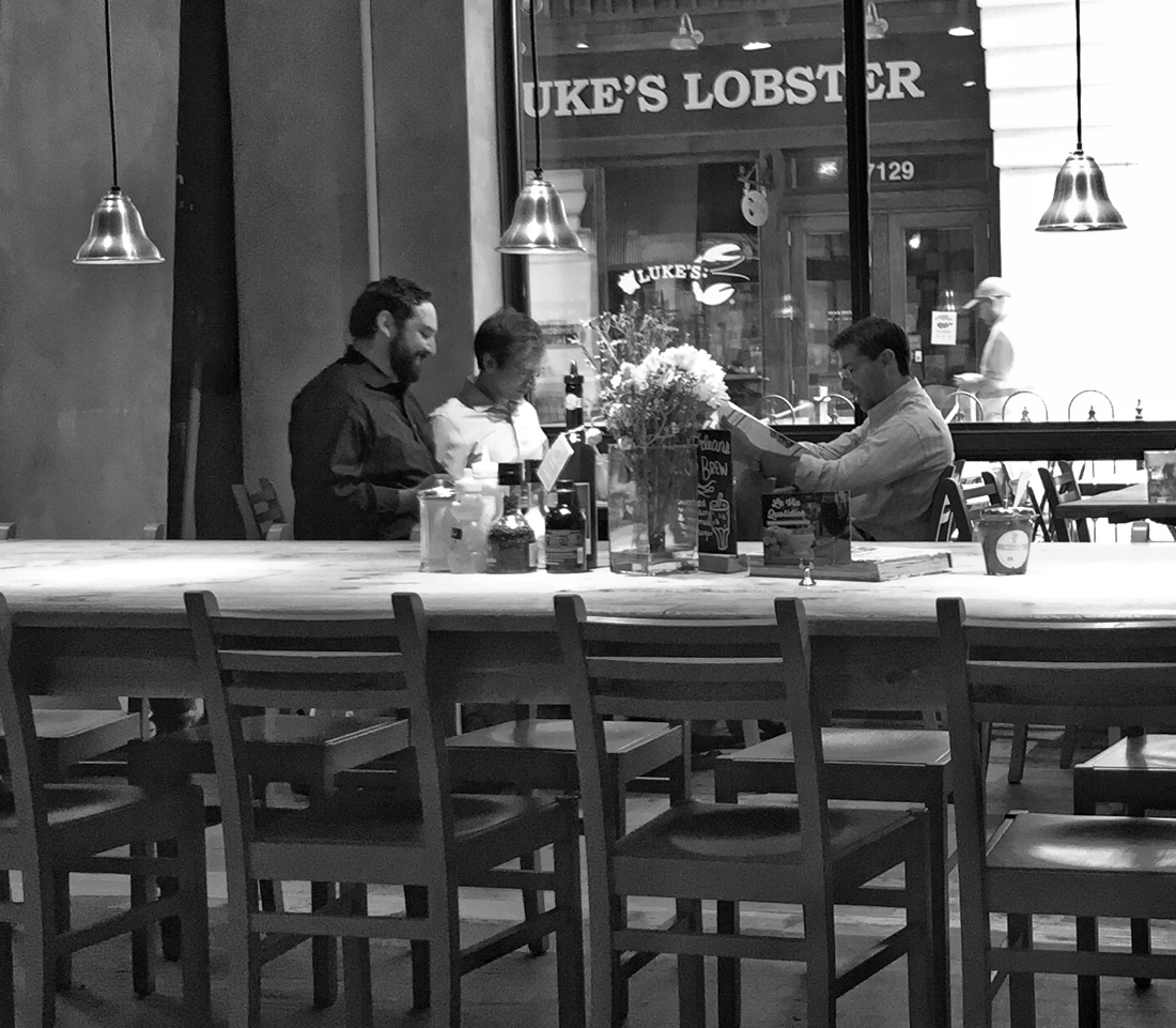three men enjoying breakfast at Le Pain Quotidien in Bethesda, Maryland