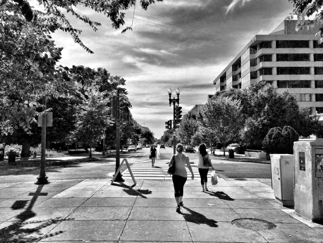 People walking from Dupont Circle towards Massachusetts Ave, NW in Washington DC