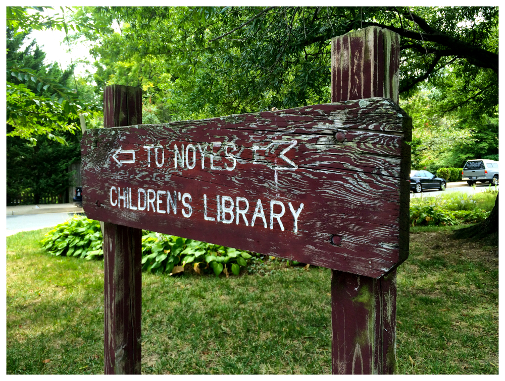 Sign pointing the way to Noyes Children's Library in kensington, Maryland