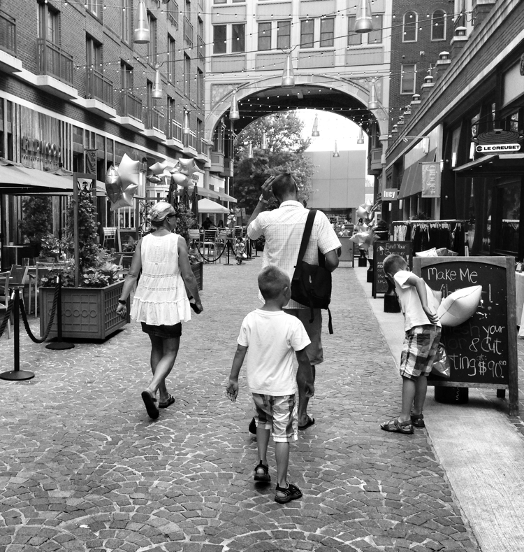 A family walking down Bethesda Lane on a beautiful afternoon in Bethesda, Maryland