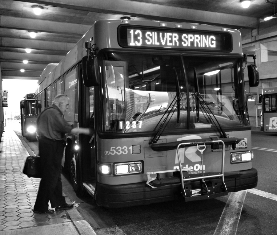 Man boarding the number 13 bus ib Silver Spring, Maryland