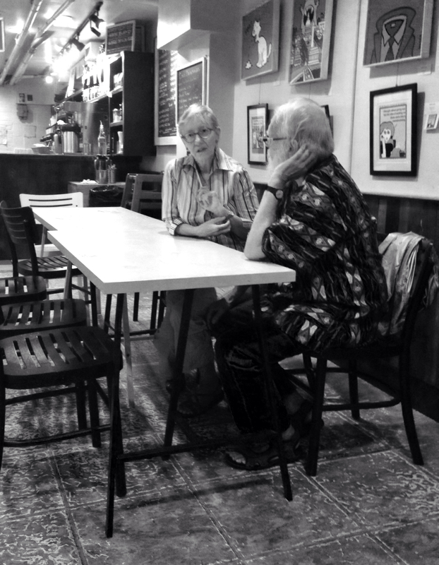 A couple in conversation at the Modern Times Cafe in Washington DC