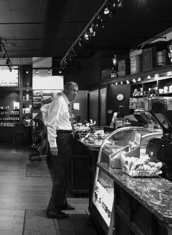 Man waiting to order his morning coffee