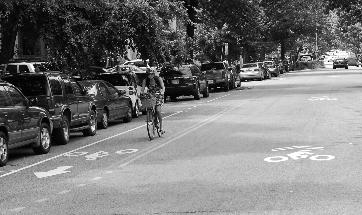 Girl riding a bike on New Jersey Ave, NW in Washington, DC