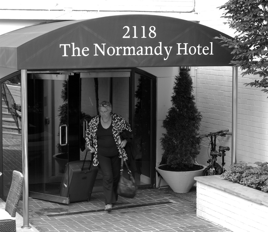 Guest leaving the Normandy Hotel on Wyoming Ave, NW in Washington DC