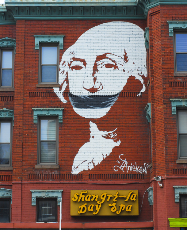 A mural of a gagged President Washington at 1502 U Street NW in Washington DC