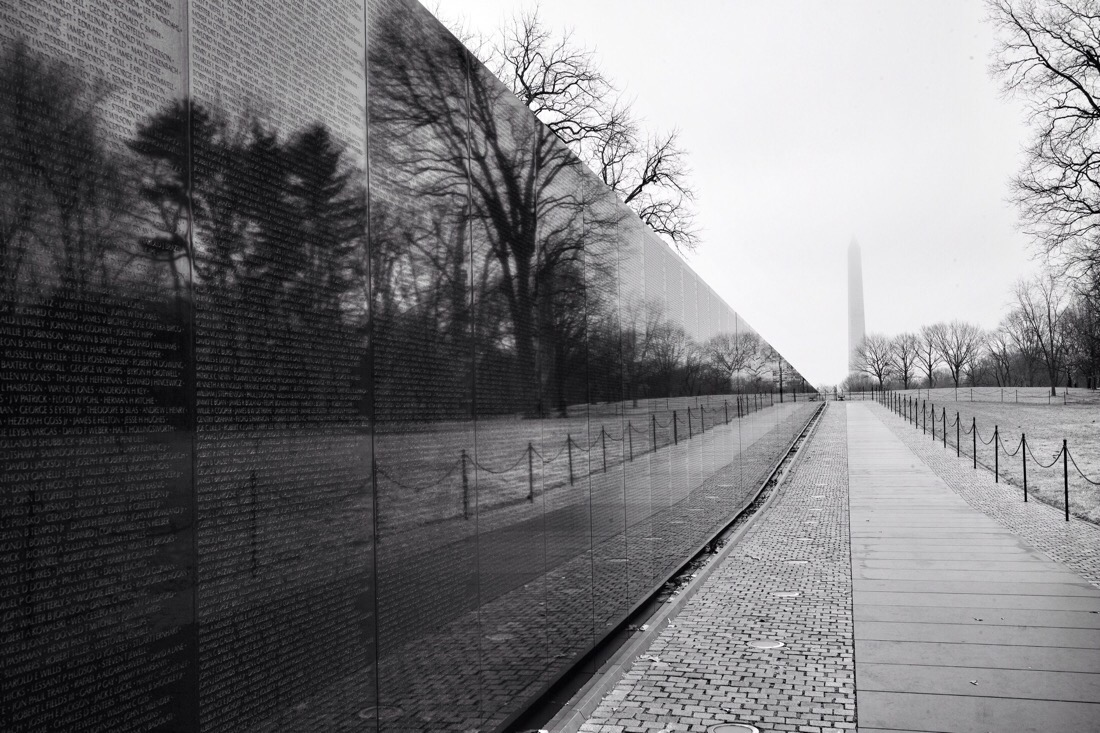 Looking along the wall at the Vietnam Veterans Memorial towards the Washington Monument in Washington DC