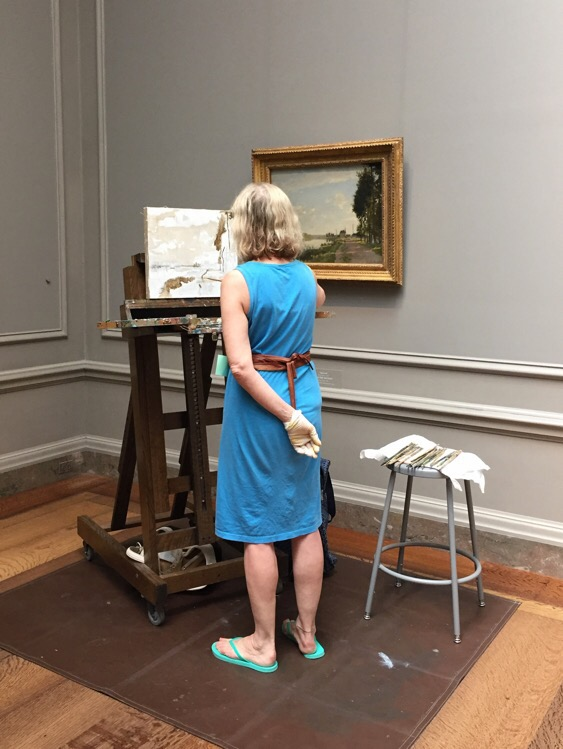 woman painting a copy of a painting in the national gallery of art in washington dc