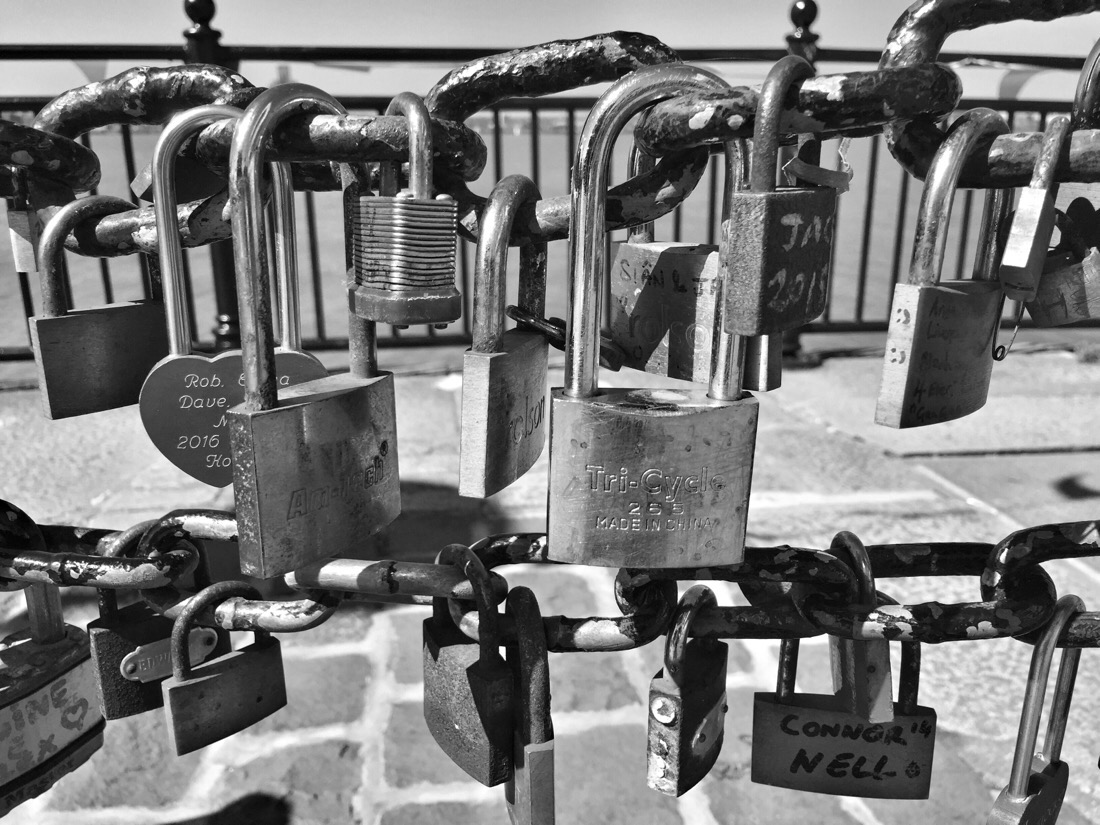 locks on a chain at the pier head in liverpool
