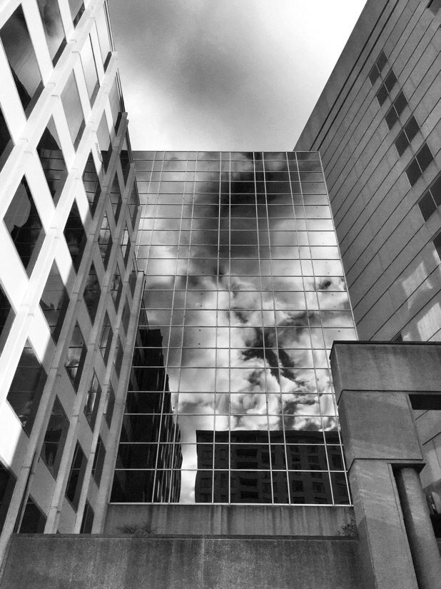 Clouds reflected in a glass building in Bethesda, md
