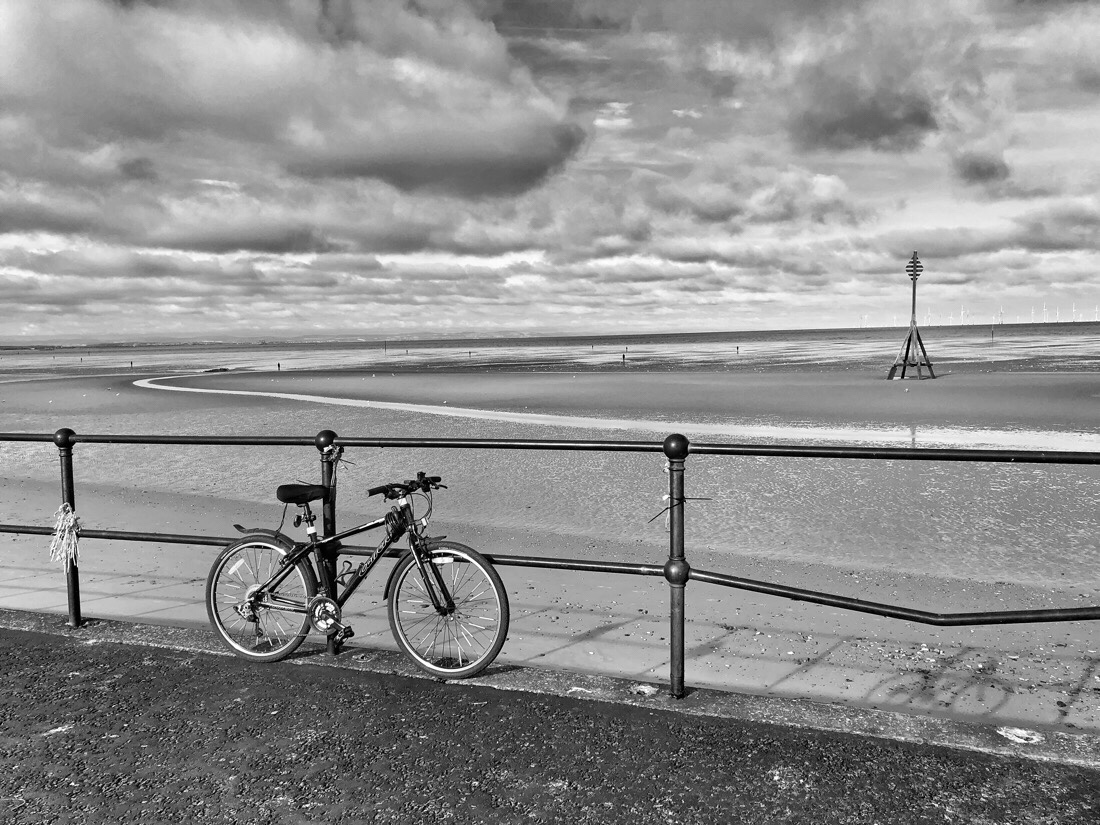 Riding a bike along the beach front from Crosby to Ainsdale