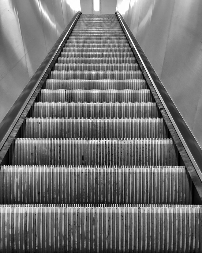 Up and down the escalators at Liverpool central station on the Merseyrail network in Liverpool