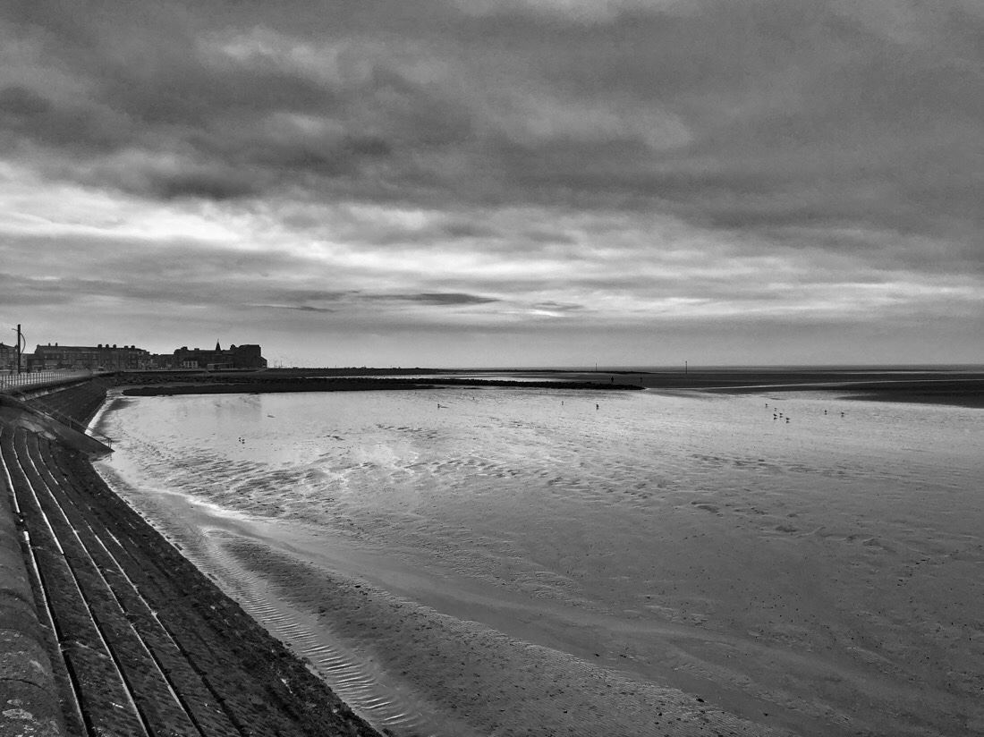 An afternoon walk along the promenade of Morecambe south beach in Morecambe, lancashire in the north west of England.