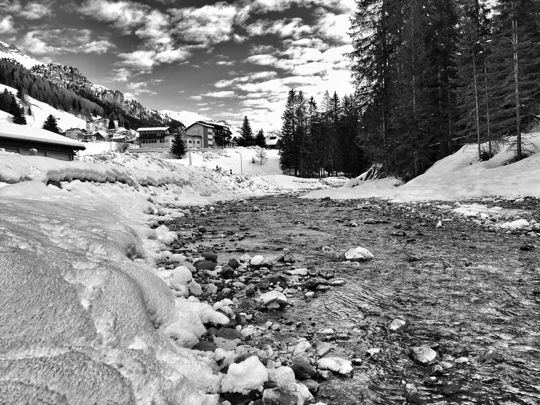 Walking along the Torrente Avisio from Alba to Pozza di Fassa in the Dolomite Mountains in Northern Italy