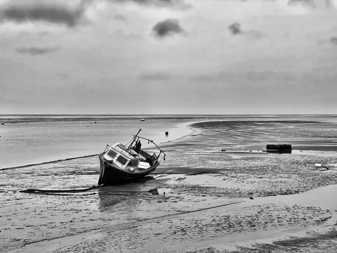 A wet and windy day walking along Meols Parade on the The Wirral, UK