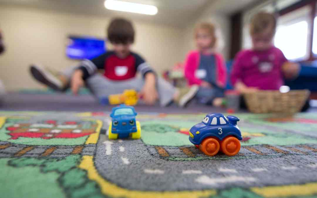 kids playing with daycare toys