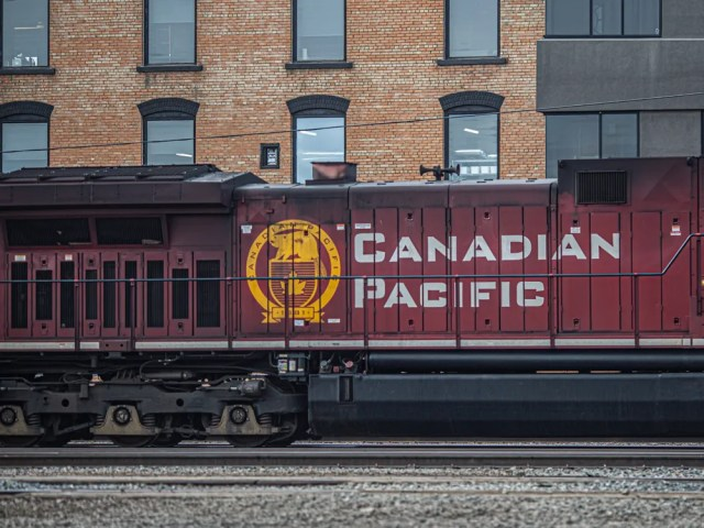 A Canadian Pacific Railway locomotive painted with the company logo at a rail yard in Calgary.