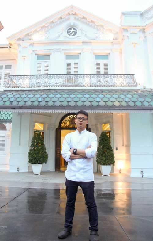 Chef Johnson Wong stands outside Macalister Mansion